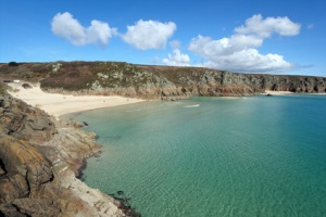 Porthcurno beach and turquoise sea, Cornwall UK.