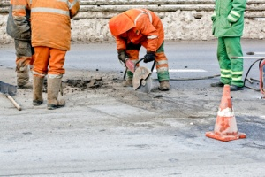 Cutting road works with hydraulic driven angle grinder