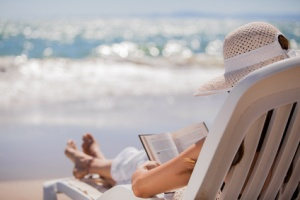 Relaxing and reading at the beach