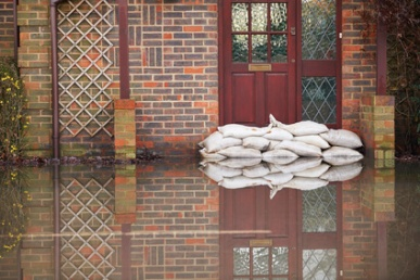 Sandbags Outside Front Door Of Flooded House
