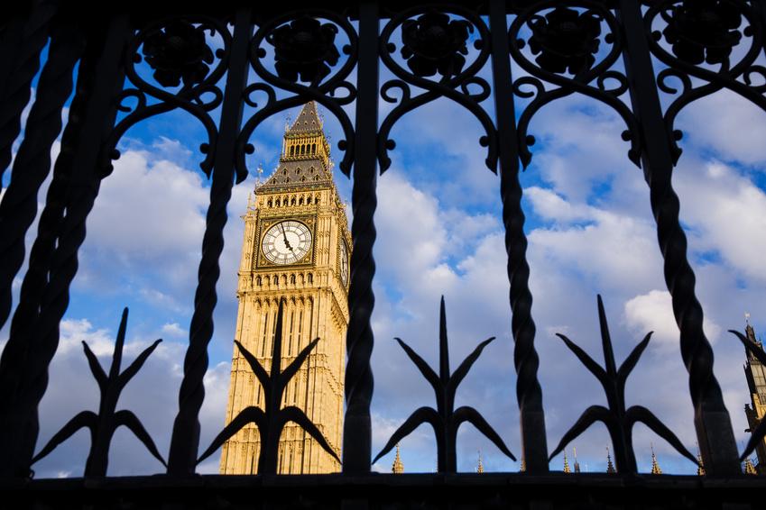 Big Ben seen through the ornate metal security gates, Westminster, UK
