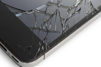 Macro photo of an cell phone with broken display screen isolated