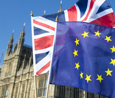 European Union and British Union Jack flag flying in front of Bi