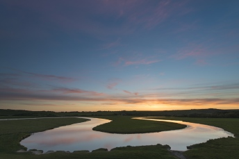Sunset reflected in the meanders of the Cuckmere River, Cuckmere Valley, East Sussex.
