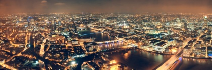 London aerial view panorama at night with urban architectures and bridges.