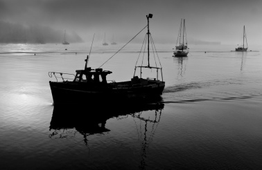 A Fishing boat returns, Saltash in Cornwall. England.