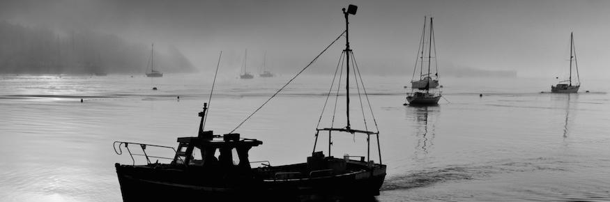A Fishing boat returns, Saltash in Cornwall. England.