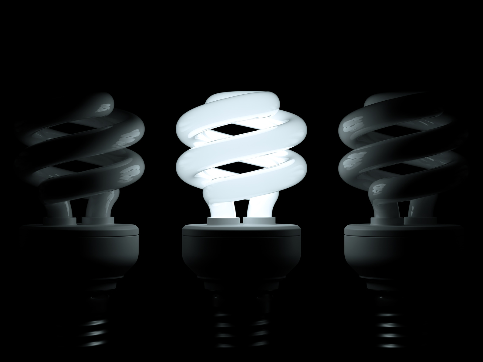 Glowing lightbulb illuminating other ones